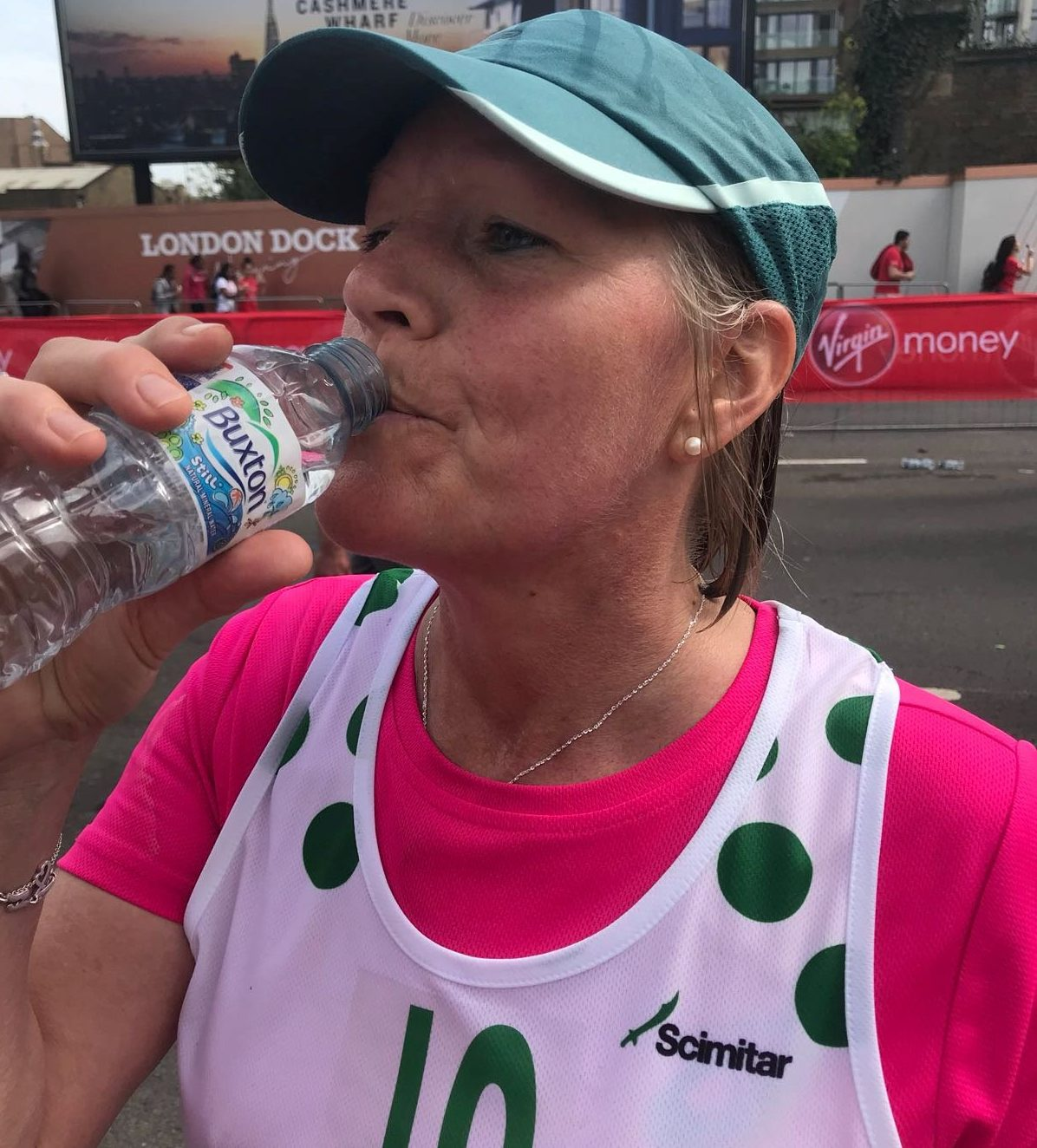 Johanna Pakenham pictured at the London Marathon - the runner was left fighting for her life after drinking too much water at the event. See SWNS story SWMARATHON; A London Marathon runner was left fighting for her life and in a coma after drinking too much WATER during the race. Johanna Pakenham, 53, unknowingly overloaded her body with more than a dozen bottles of water to cope with the heat and has no recollection of crossing the finish line. The mum-of-four later collapsed at home, suffered a seizure, and her partner was forced to perform CPR to keep her alive before the ambulance arrived. By taking in too much fluid during the race, Joanna had flushed the sodium out of her system, resulting in the life-threatening condition know has hyponatremia.