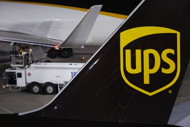 United Parcel Service Inc. (UPS) signage is displayed on the tail section of a cargo jet on the tarmac at the UPS Worldport facility in Louisville, Kentucky, U.S., on Thursday, July 21, 2016. United Parcel Service Inc. is scheduled to release earnings results on July 29. Photographer: Luke Sharrett/Bloomberg via Getty Images