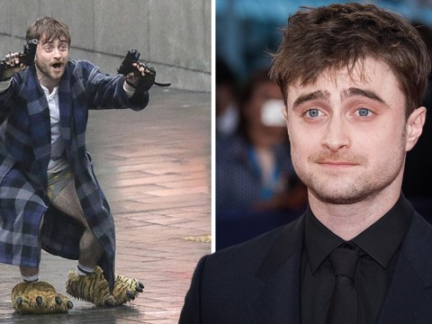 Gun-toting Daniel Radcliffe is miles from Harry Potter as he sports bloody knuckles and garish ensemble