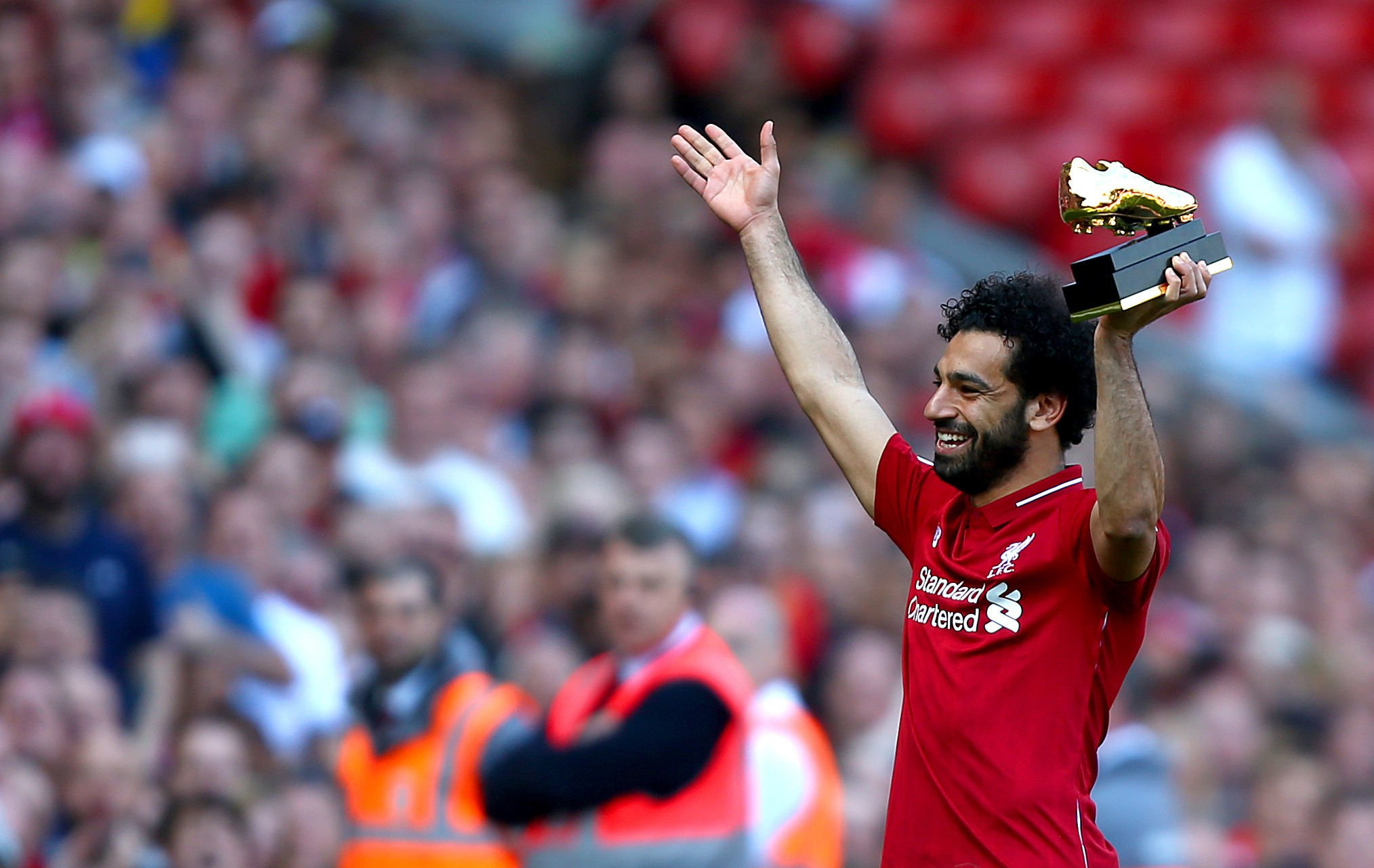 """Liverpool's Mohamed Salah with the golden boot award after the Premier League match at Anfield, Liverpool. PRESS ASSOCIATION Photo. Picture date: Sunday May 13, 2018. See PA story SOCCER Liverpool. Photo credit should read: Dave Thompson/PA Wire. RESTRICTIONS: EDITORIAL USE ONLY No use with unauthorised audio, video, data, fixture lists, club/league logos or """"live"""" services. Online in-match use limited to 75 images, no video emulation. No use in betting, games or single club/league/player publications."""