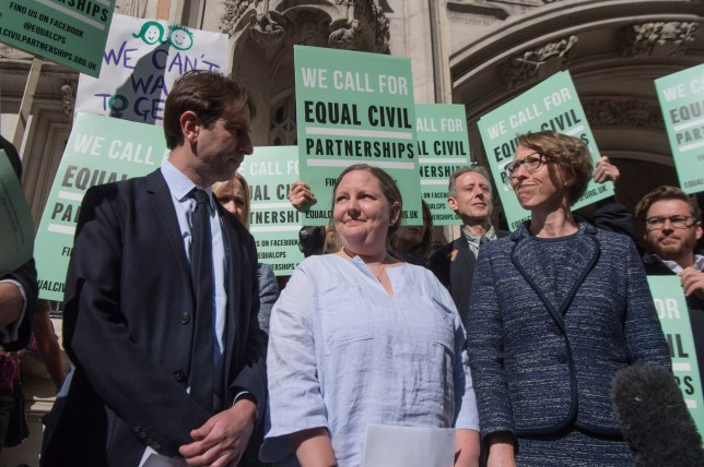 Rebecca Steinfeld (centre) and Charles Keidan outside the Supreme Court in London, the heterosexual couple who want the right to enter into a civil partnership are taking their fight to the UK's highest court. PRESS ASSOCIATION Photo. Picture date: Monday May 14, 2018. Rebecca Steinfeld, 37, and Charles Keidan, 41, want a legal union through that route but are prevented because the Civil Partnership Act 2004 says only same-sex couples are eligible. See PA story COURTS Partnership. Photo credit should read: Victoria Jones/PA Wire