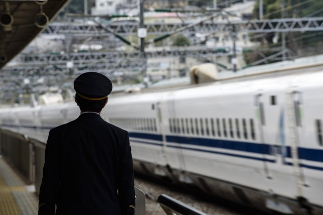 March 13, 2016 - Odawara, Kanagawa, Japan - A train attendant checks the platform as a bullet train passes at Odawara Station, Japan, in a file photo taken March 13, 2016. On Thursday, October 12, two major Japanese railways, Central Japan Railway and West Japan Railway, announced that substandard parts from Kobe Steel Ltd. were used in the manufacture of some of their bullet trains. Kobe Steel has admitted to falsifying data on aluminum, copper and iron ore parts. On Friday the company announced it had shipped untested or substandard steel wire, expanding the number of affected clients now to around 500 firms. Kobe Steel's stock price has fallen 41 percent in the past week, fueling talk of breaking up the company. (Credit Image: ? Ben Weller via ZUMA Wire)