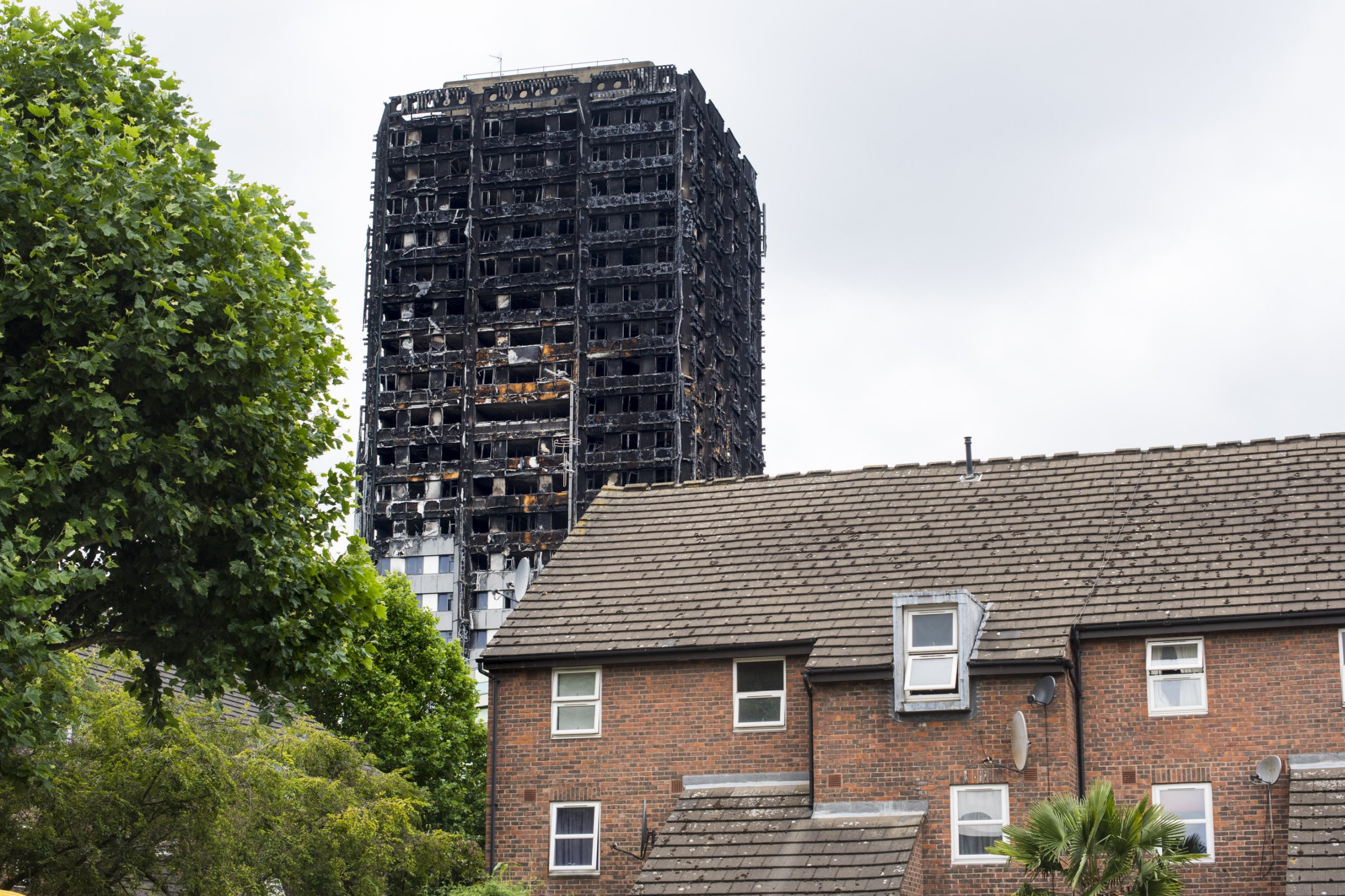 Grenfell review branded a 'betrayal' for failing to ban flammable cladding