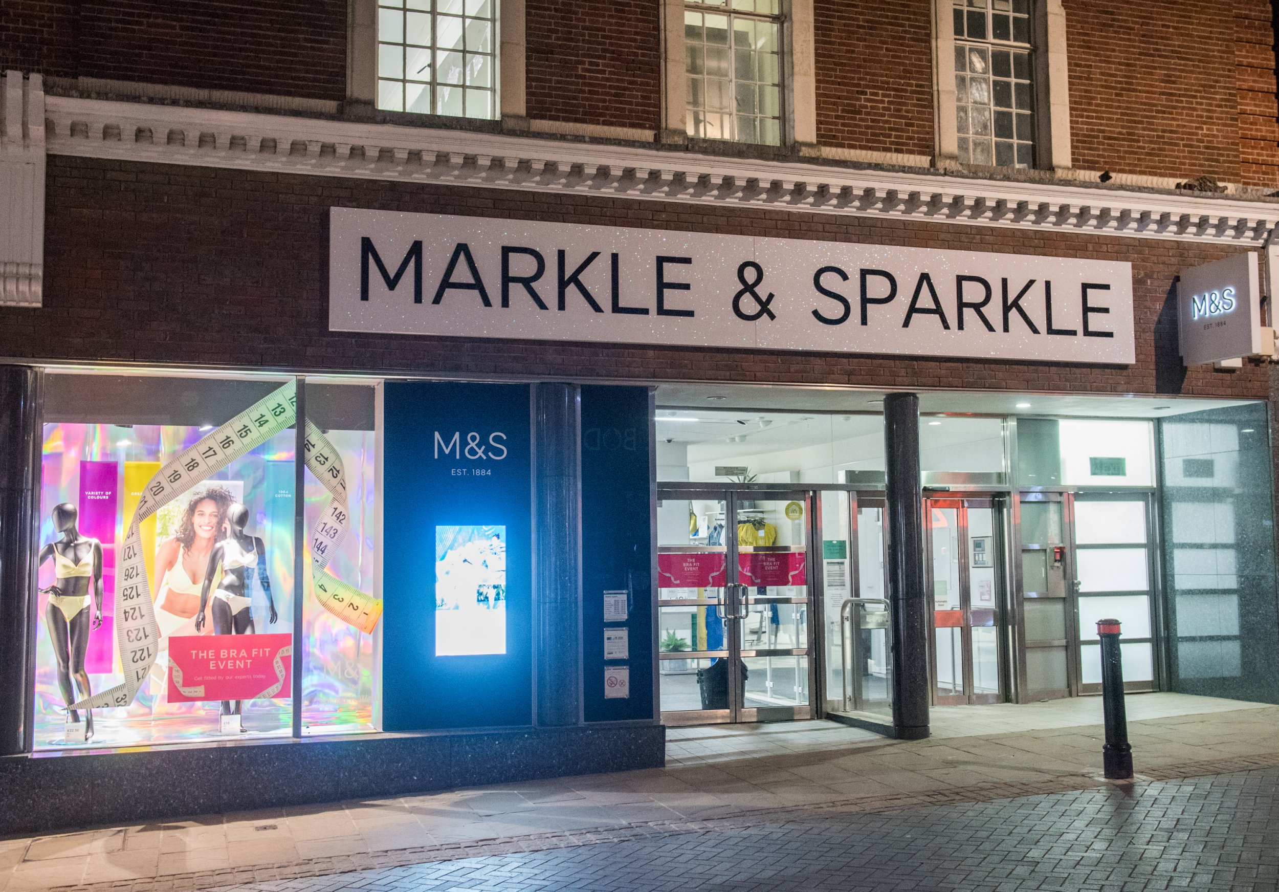 WINDSOR, ENGLAND - MAY 17: A Marks & Spencer store is seen with its name changed to 'Markle & Sparkle' ahead of the Royal wedding on May 17, 2018 in Windsor, England. Preparations continue in the town for the wedding between Prince Harry and Ms. Meghan Markle on May 19, 2018 when tens of thousands of well wishers will descend on the town just west of London to celebrate the couple's big day. (Photo by Samir Hussein/Samir Hussein/WireImage)
