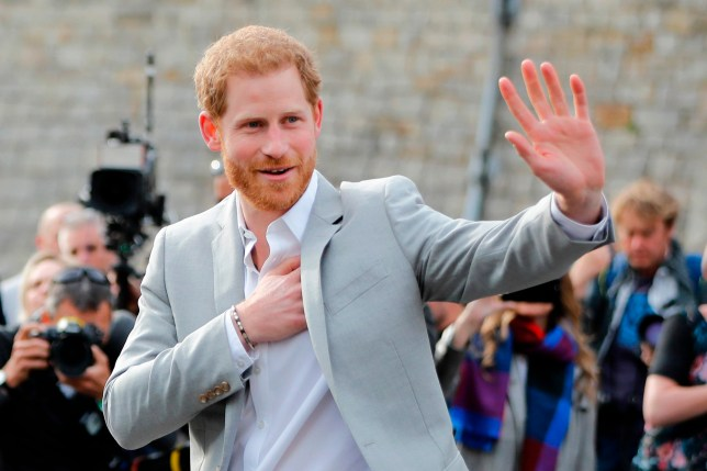 Britain's Prince Harry greets well-wishers on the street outside Windor Castle in Windsor on May 18, 2018, the eve of Britain's Prince Harry's royal wedding to US actress Meghan Markle. Britain's Prince Harry and US actress Meghan Markle will marry on May 19 at St George's Chapel in Windsor Castle. / AFP PHOTO / Tolga AKMENTOLGA AKMEN/AFP/Getty Images