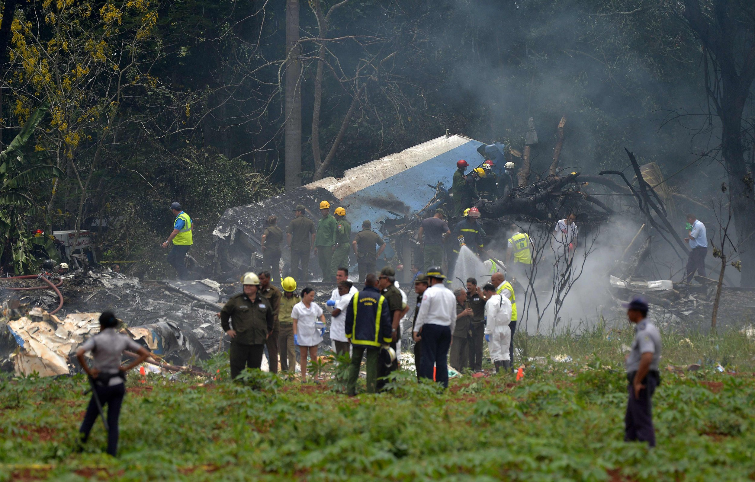 """Picture taken at the scene of the accident after a Cubana de Aviacion aircraft crashed after taking off from Havana's Jose Marti airport on May 18, 2018. A Cuban state airways passenger plane with 104 passengers on board crashed on shortly after taking off from Havana's airport, state media reported. The Boeing 737 operated by Cubana de Aviacion crashed """"near the international airport,"""" state agency Prensa Latina reported. Airport sources said the jetliner was heading from the capital to the eastern city of Holguin. / AFP PHOTO / Yamil LAGEYAMIL LAGE/AFP/Getty Images"""