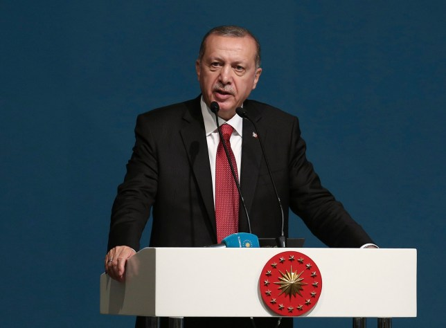 Turkey's President Recep Tayyip Erdogan speaks during the extraordinary summit of the Organization of Islamic Cooperation (OIC), in Istanbul, Turkey, Friday, May 18, 2018. Turkey has called on Muslim nations to stand with Palestinians and to work to stop countries joining the United States in relocating their Israeli embassy from Tel Aviv to Jerusalem. (Presidential Press Service/Pool via AP)