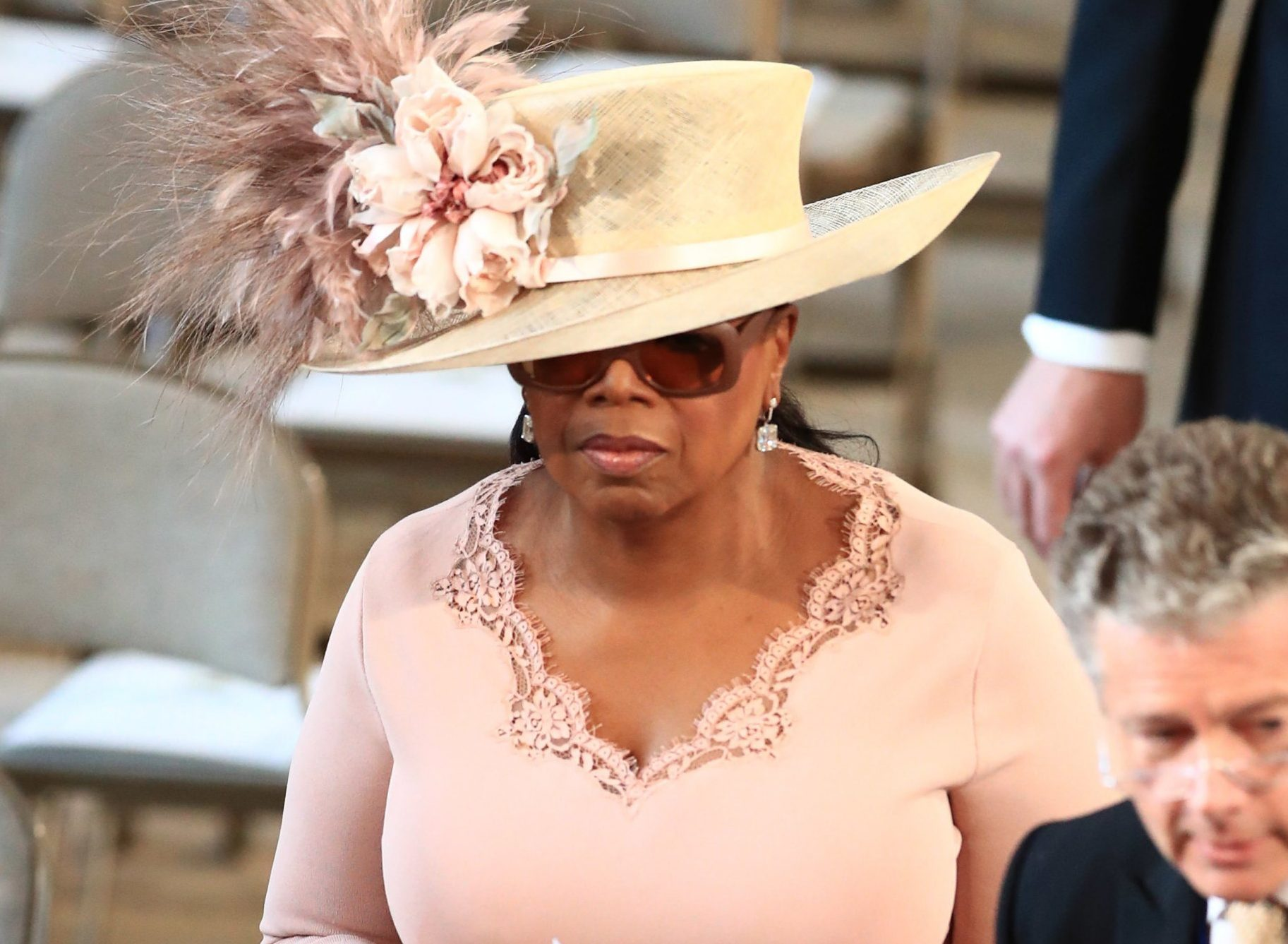 Oprah Winfrey is pretty much royalty as she attends royal wedding in amazing hat