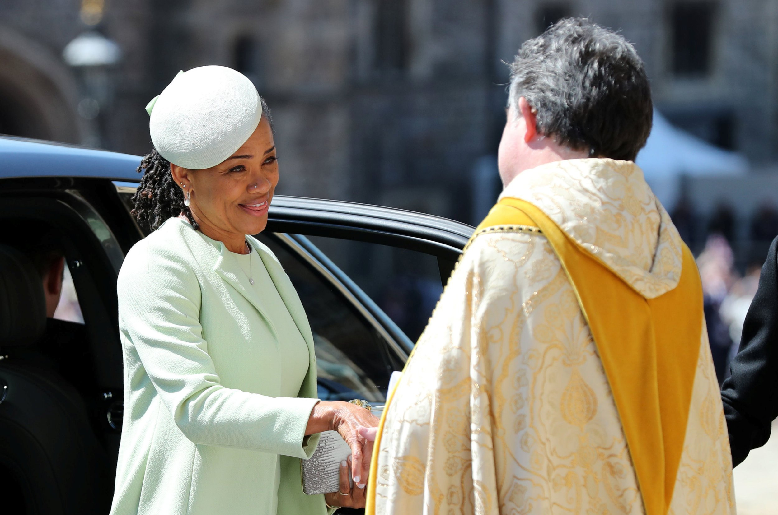 Meghan's mum Doria looks like a queen in light green suit by Oscar de la Renta