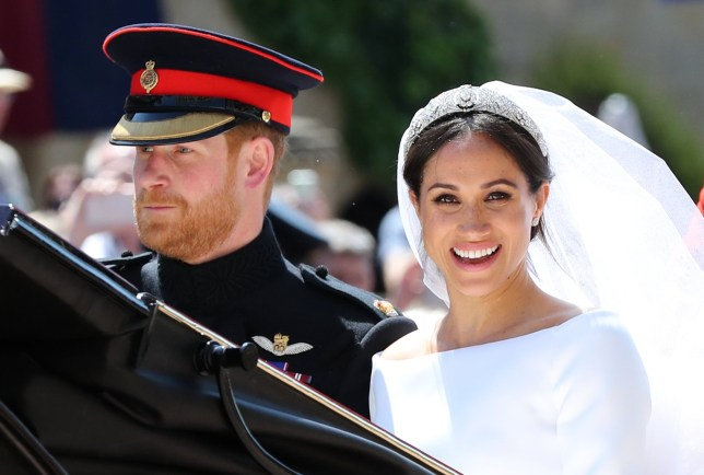 Meghan Markle and Prince Harry leave St George's Chapel at Windsor Castle after their wedding PRESS ASSOCIATION Photo. Picture date: Saturday May 19, 2018. See PA story ROYAL Wedding. Photo credit should read: Gareth Fuller/PA Wire