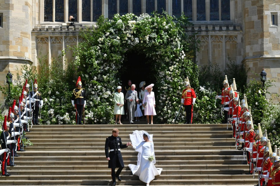 Prince Harry and Meghan Markle leave St George's Chapel in Windsor Castle after their wedding. PRESS ASSOCIATION Photo. Picture date: Saturday May 19, 2018. See PA story ROYAL Wedding. Photo credit should read: Ben Birchall/PA Wire