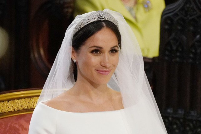TOPSHOT - US fiancee of Britain's Prince Harry, Meghan Markle arrives at the High Altar for their wedding ceremony in St George's Chapel, Windsor Castle, in Windsor, on May 19, 2018. / AFP PHOTO / POOL / Jonathan BradyJONATHAN BRADY/AFP/Getty Images