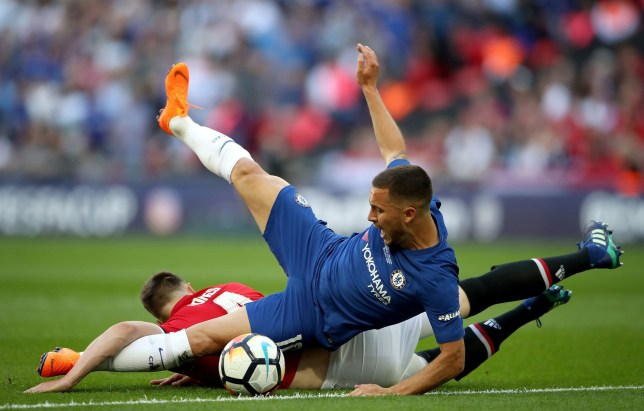 """Manchester United's Phil Jones fouls Chelsea's Eden Hazard (front) in the area to give away a penalty during the Emirates FA Cup Final at Wembley Stadium, London. PRESS ASSOCIATION Photo. Picture date: Saturday May 19, 2018. See PA story SOCCER FA Cup. Photo credit should read: Nick Potts/PA Wire. RESTRICTIONS: EDITORIAL USE ONLY No use with unauthorised audio, video, data, fixture lists, club/league logos or """"live"""" services. Online in-match use limited to 75 images, no video emulation. No use in betting, games or single club/league/player publications."""