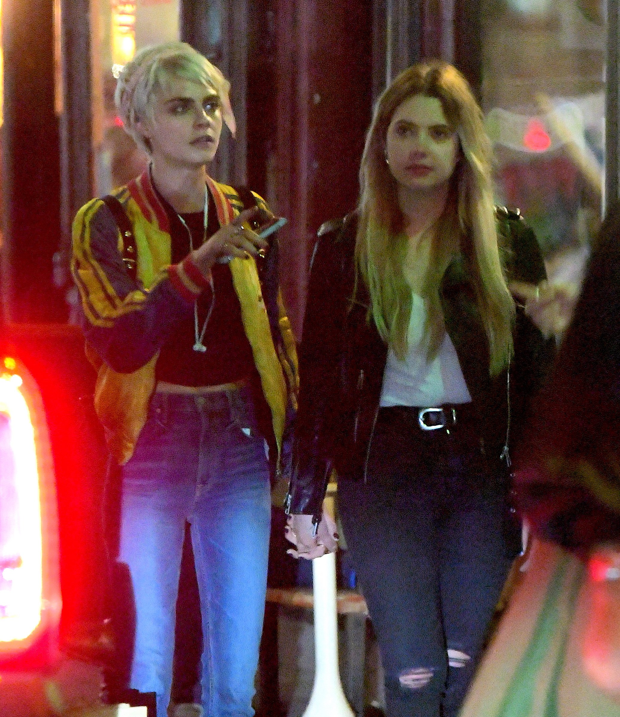 **UK WEB ??300 SET FEE**UK PAPERS MIN FEE ??300PP** EXCLUSIVE: **PREMIUM EXCLUSIVE RATES** The pair were spotted leaving Lucky Strike, a small bar/ restaurant in Soho with a few pals. Cara and Ashley emerged holding hands at 2am after enjoying dinner and drinks inside. They walked down the street to the Soho Grand Hotel. As they walked holding each other's hands, they giggled before leaning in for a quick kiss. They trailed behind their friends, looking in Love. They partied at the Hotel lounge until 4am. They could be seen waiting for their car inside the hotel, but they opted to try and make a quick getaway in a decoy car. They ran out the back door of the hotel and got into a black SUV together before going back to Ashley's apartment for the night. Ref: SPL1699573 180518 EXCLUSIVE Picture by: 247PAPS.TV / Splash News Splash News and Pictures Los Angeles: 310-821-2666 New York: 212-619-2666 London: 870-934-2666 photodesk@splashnews.com