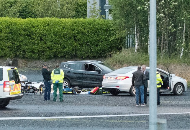 Emergency services next to a Nissan Qashqai (centre) at a business park in the Cherrywood area of Dublin where a man has been shot as police search for a missing woman feared abducted. PRESS ASSOCIATION Photo. Picture date: Sunday May 20, 2018. Jastine Valdez, 24, from Enniskerry, was last seen when she left her home on Saturday afternoon. See PA story IRISH Shooting. Photo credit should read: Peter Varga/PA Wire
