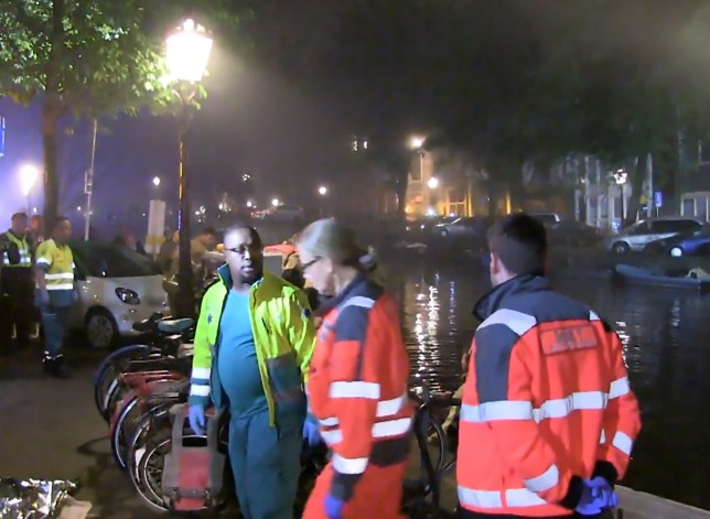 Pics shows: Rescue workers taking the British man from the canal; A British tourist has died after he fell into an a Dutch canal while doing a pee. The shocking incident happened over the weekend in the Dutch capital Amsterdam. According to eyewitnesses, the British man walked to the side of a canal in the city centre in the middle of the night. While he was peeing in the water from the side of the canal, he is said to have lost his balance, and fell into the water. One passerby tried to save the unfortunate tourist but could not pull him to dry land. Emergency services were called, as well as several fire brigade units and two ambulances that all rushed to the scene, and a special diving team eventually managed to pull the British man out of the water. Medics reportedly managed to resuscitate the British man, and he was rushed to hospital but it was later confirmed that he had died a short time after arrival. A police spokesman confirmed the drowned man was a 21-year-old British tourist who was not named due to local privacy laws. The Amsterdam Public Health Service (GGD) has warned about the danger of peeing in the city's canals while intoxicated. According to the GGD, some 200 people drown every year in the Netherlands, with about 20 of these cases happening in Amsterdam. They say the bulk of these deaths are intoxicated men who fall into the water while they are peeing along the canals. GGD forensic doctor Guido Reijnen said this is mostly because drunk people have more difficulties balancing themselves at the edge of the canal and once they have fallen in, they have more difficulties getting out of the water again. A second, often overlooked cause, is called micturition syncope, the name given to the human phenomenon of fainting shortly after or during urination. Reijnen explained that due to alcohol consumption and peeing while standing, the amount of blood going to the brain decreases as blood vessels expand. Forensic doctor Selma Eikelenboom-S