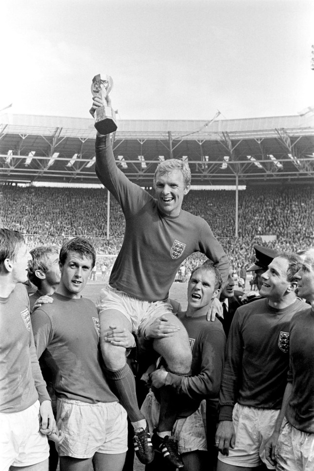 File photo dated 30/7/1966 of England's triumphant 1966 World Cup final captain Bobby Moore chaired by hat-trick hero Geoff Hurst (L) and Ray Wilson as he salutes the crowd with the Jules Rimet Trophy after the 4-2 victory against West Germany at Wembley. A London gangster and his brother were behind the notorious unsolved theft of the World Cup trophy just months before the 1966 tournament in England, it has been claimed. PRESS ASSOCIATION Photo. Issue date: Thursday May 24, 2018. Sidney Cugullere, with the help of his brother Reg, stole the Jules Rimet trophy while it was on public exhibition at the Methodist Central Hall in Westminster, Reg's son Gary said. See PA story SPORT JulesRimet. Photo credit should read: PA Wire
