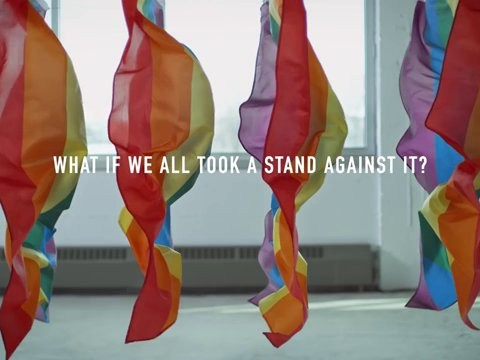 Watch these LGBTQ flags become bulletproof in anti-violence protest