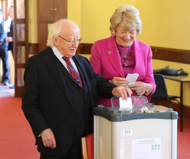 President Michael D Higgins and his wife Sabina cast their votes at the polling station in St Mary's Hospial, Pheonix Park, Dublin, as the country goes to the polls to vote in the referendum on the 8th Amendment of the Irish Constitution. PRESS ASSOCIATION Photo. Picture date: Friday May 25, 2018. See PA story IRISH Abortion. Photo credit should read: Niall Carson/PA Wire
