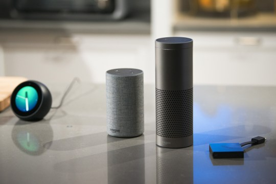 The new Amazon.com Inc. Echo Spot, from left, Echo, Echo Plus, and Fire TV devices sit on display during the company's product reveal launch event in downtown Seattle, Washington, U.S., on Wednesday, Sept. 27, 2017. Amazon unveiled a smaller, cheaper version of its popular Alexa-powered Echo speaker that the e-commerce giant said has better sound. Photographer: Daniel Berman/Bloomberg via Getty Images