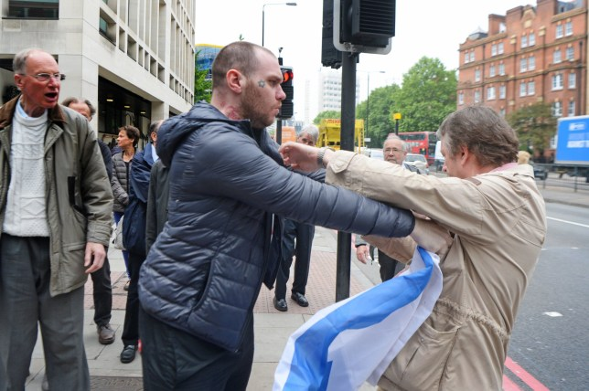 A scuffle ensues outside Westminster Magistrates' Court, London, where Blogger Alison Chabloz of Charlesworth, Glossop, Derbyshire, was found guilty of posting anti-Semitic songs online. PRESS ASSOCIATION Photo. Picture date: Friday May 25, 2018. See PA story COURTS Chabloz. Photo credit should read: Victoria Jones/PA Wire