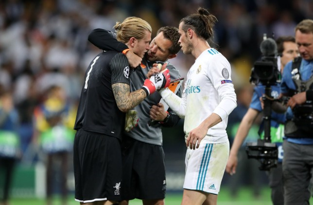 Liverpool goalkeeper Loris Karius is consoled by Liverpool goalkeeping coach John Achterberg (centre) and Real Madrid's Gareth Bale after the UEFA Champions League Final at the NSK Olimpiyskiy Stadium, Kiev. PRESS ASSOCIATION Photo. Picture date: Saturday May 26, 2018. See PA story SOCCER Champions League. Photo credit should read: Nick Potts/PA Wire