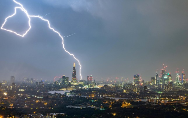A dramatic bolt of lightning lights up the sky above The Shard, London on saturday night, May 27, 2018. After a sunny start to the Bank Holiday weekend, with temperatures reaching 27C (80.6F), Saturday's balmy evening eventually broke into a violent thunderstorm accompanied by heavy rain.