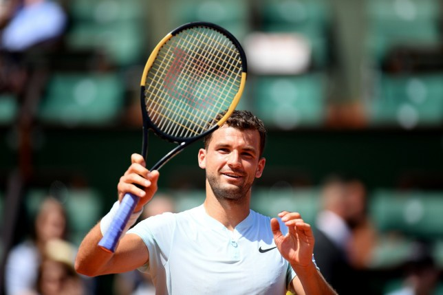 Bulgaria's Grigor Dimitrov celebrates after winning his men's singles first round match against Egypt's Mohamed Safwat on day one of The Roland Garros 2018 French Open tennis tournament in Paris on May 27, 2018. / AFP PHOTO / CHRISTOPHE ARCHAMBAULTCHRISTOPHE ARCHAMBAULT/AFP/Getty Images