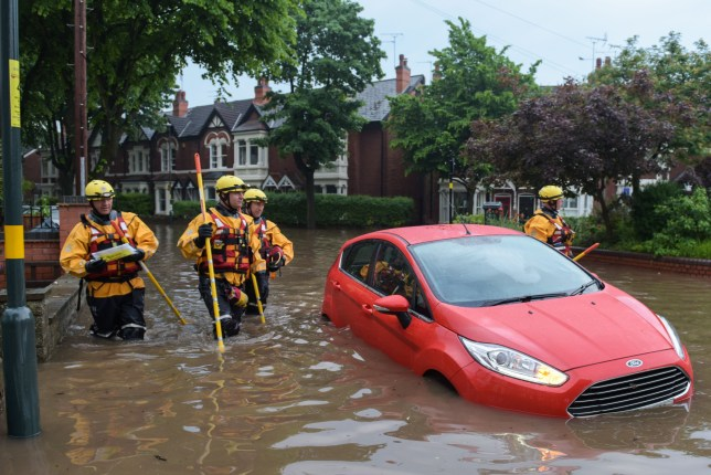 Pic by Michael Scott/Caters News - (PICTURED: Residents on Sir Johns Road in Selly Oak, Birmingham had to be rescued by firefighters using boats. Pic taken 27/05/2018.) - MAJOR flooding hit Birmingham and the West Midlands today, flooding properties and vehicles. Twenty people had to be rescued from a double decker bus on Pershore Road, whilst residents on Sir Johns Road and Fourth Avenue in the Selly Oak area had to rescued by firefighters using boats. ENDS