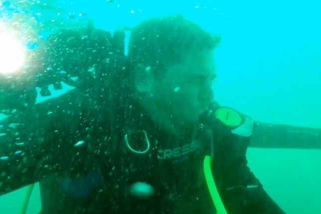 PIC FROM Nick Burke / Caters News - (PICTURED: Nick Burkes footage of the moments when Matt Henderson was losing oxygen as his diving gear was failing in Western Australia.VID TAKEN ON 13/05/18) - This nail-biting footage shows the terrifying moment a diver saved his friends life after his oxygen tank failed at 100ft underwater. Body cam footage shows Nick Burke, 37, rushing to the aid of Matt Henderson in murky waters off the coast of Perth in Western Australia on Sunday.The friends were finishing up their 30-minute dive when they realized they were in deep trouble Matts gear was failing and he was losing oxygen fast.SEE CATERS COPY