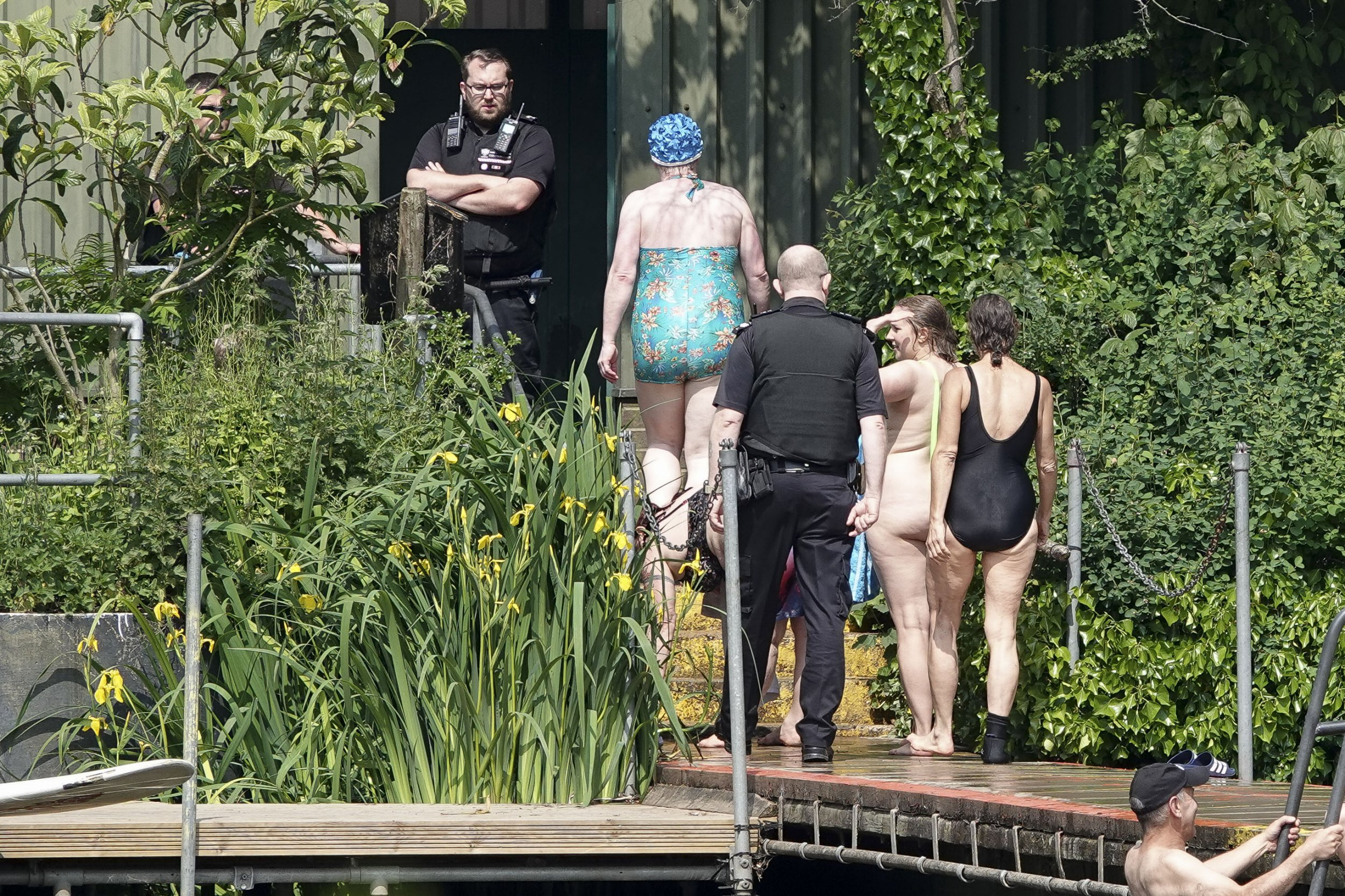 "Members of ""Man Friday"" disrupt the men only bathing session at Hampstead Heath Pools in a protest over the gender fluid situation rule imposed on the Women only pool nearby. Police arrive at the pools, after which they decided to not take any action. Please legal."