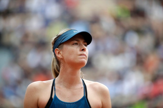 Russia's Maria Sharapova looks up during her first round match against Netherland's Richel Hogenkamp at the French Open tennis tournament in the Roland Garros stadium in Paris, France, Tuesday, May 29, 2018. (AP Photo/Alessandra Tarantino)