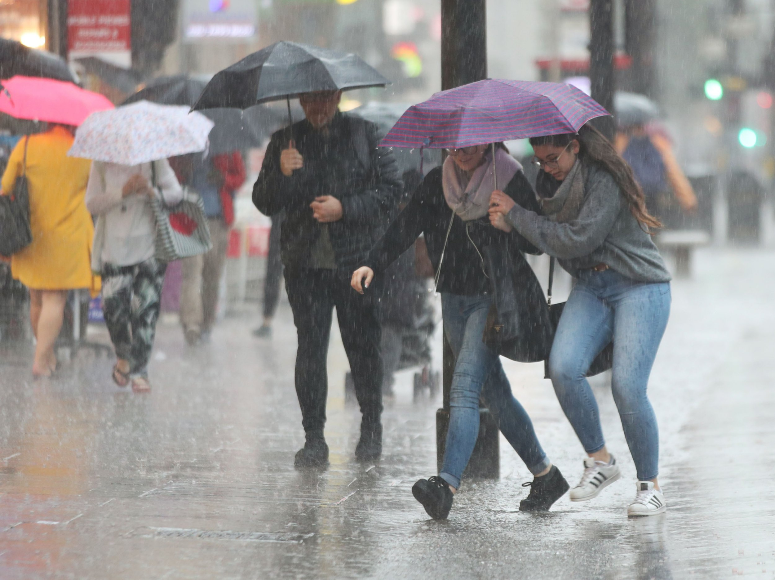 People caught in the rain on Oxford Street, central London as forecasters have warned of the risk of more flooding, travel disruption and power cuts with thunderstorms set to rumble on. PRESS ASSOCIATION Photo. Picture date: Tuesday May 29, 2018. Those off for half-term have been told to beware of potential flash floods and sudden worsening of visibility amid heavy rain and balmy temperatures. The Met Office has issued a yellow alert warning of thundery rain or showers which could bring local flooding to parts of southern England and Wales through Tuesday and into Wednesday morning. Photo credit should read: Yui Mok/PA Wire