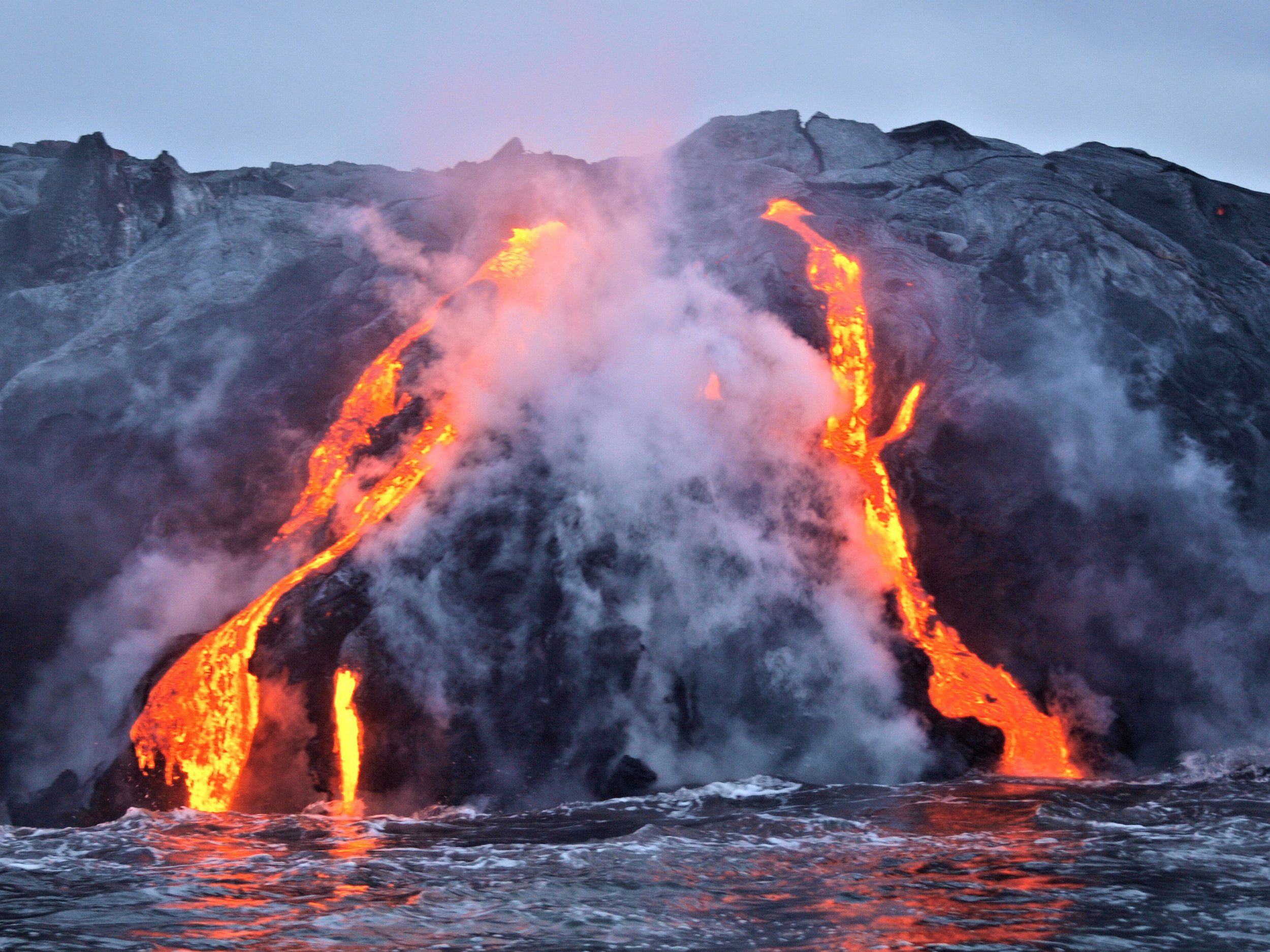 Lava flow into the ocean from the Kilauea Volcano on the Big Island of Hawaii.
