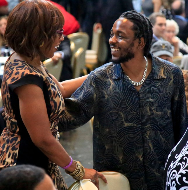 CBS news anchor Gayle King, left, meets with Pulitzer Prize winner for music Kendrick Lamar during the 2018 Pulitzer Prize awards luncheon ceremony at Columbia University, Wednesday May 30, 2018, in New York. (AP Photo/Bebeto Matthews)