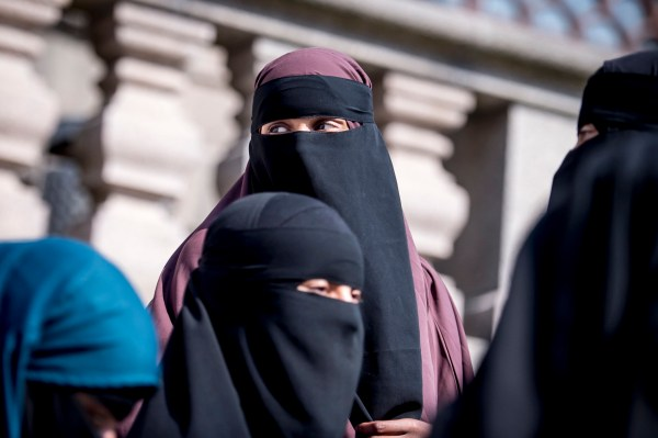 Women wearing the islamic veil niqab stand outside the Danish Parliament, at Christiansborg Castle, in Copenhagen, Denmark, Thursday May 31. 2018. Denmark joined some other European countries in deciding Thursday to ban garments that cover the face, including Islamic veils such as the niqab or burqa. (Mads Claus Rasmussen/Ritzau Scanpix via AP)