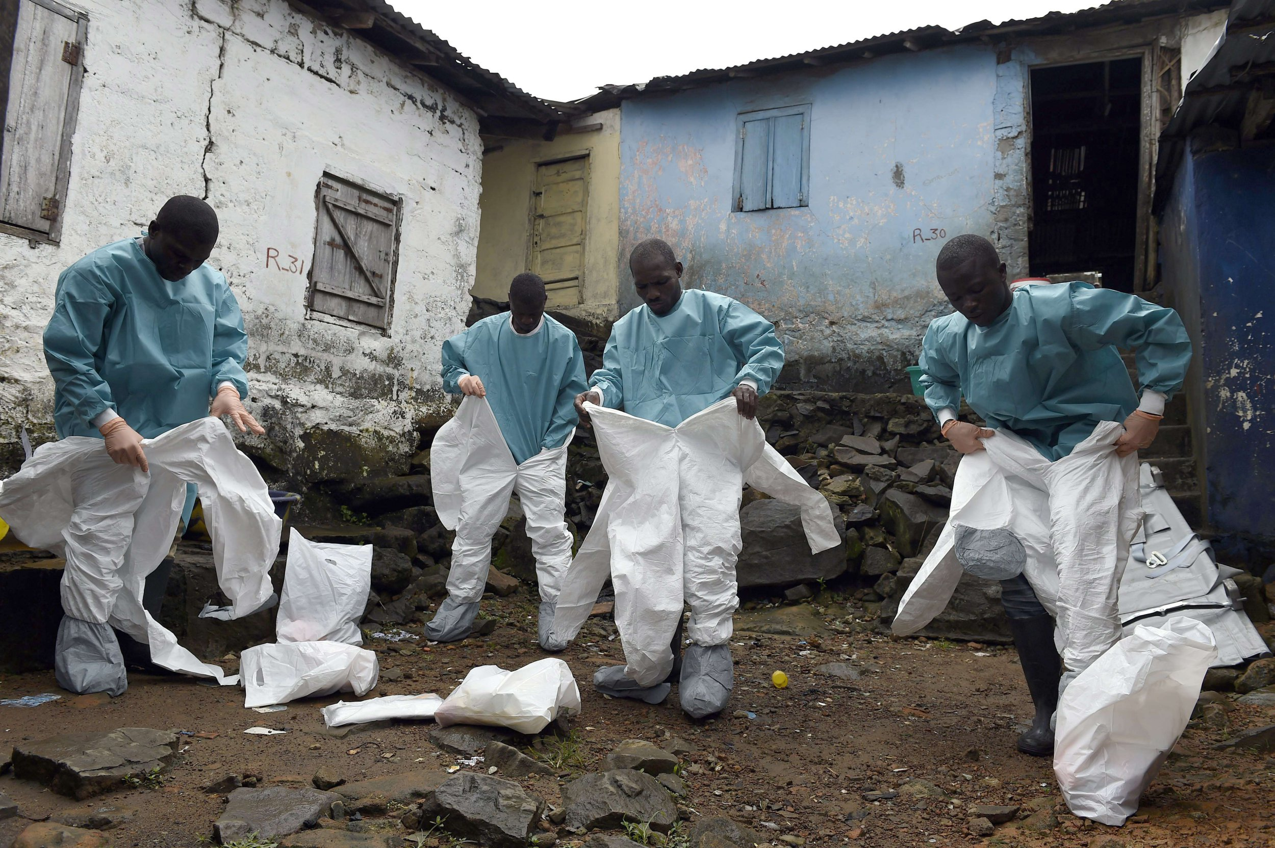 -- AFP PICTURES OF THE YEAR 2014 -- Medical staff members of the Croix Rouge NGO put on protective suits before collecting the corpse of a victim of Ebola, in Monrovia, on September 29, 2014. Of the four west African nations affected by the Ebola outbreak, Liberia has been hit the hardest, with 3,458 people infected -- more than half of the total number of cases. Of those, 1,830 have died, according to a WHO count released on September 27. AFP PHOTO / PASCAL GUYOTPASCAL GUYOT/AFP/Getty Images