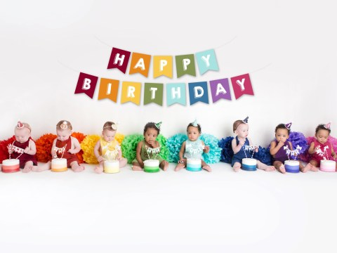 Two sets of quadruplets smash cakes in first birthday themed photoshoot