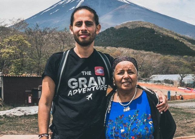 Nathanel Creson and grandmother Safta in front of Mount Fuji
