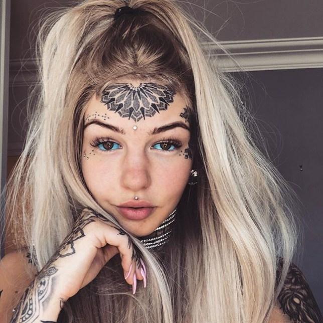 Woman in Australia gets eyeballs tattooed blue in latest body art ...