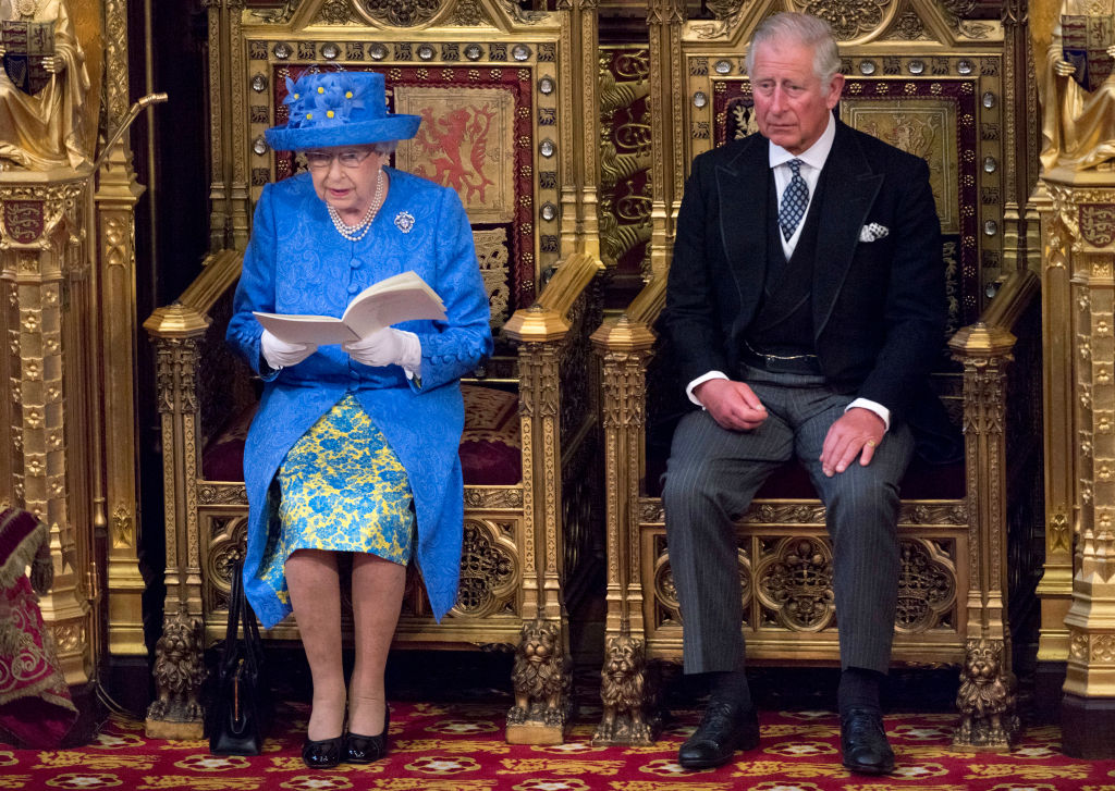 LONDON, UNITED KINGDOM - JUNE 21: Queen Elizabeth II delivers the Queen's Speech whilst sat next to Prince Charles, Prince of Wales during the State Opening of Parliament in the House of Lords at the Palace of Westminster on June 21, 2017 in London, United Kingdom. This year saw a scaled-back State opening of Parliament Ceremony with the Queen arriving by car rather than carriage and not wearing the Imperial State Crown or the Robes of State. (Photo by Arthur Edwards - WPA Pool/Getty Images)