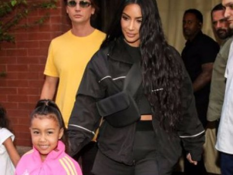 North West looks adorable as she 'wears hair extensions' on her way to the sweet shop