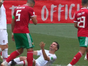 Pepe collapses to the ground after pat on the back from Medhi Benatia