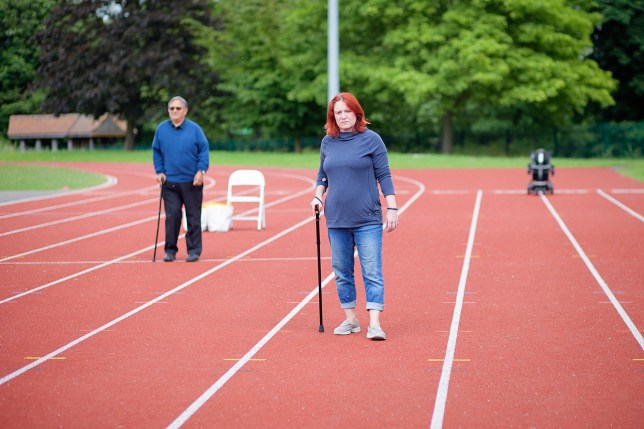 MS sufferers attempt to walk 20 metres on a race track
