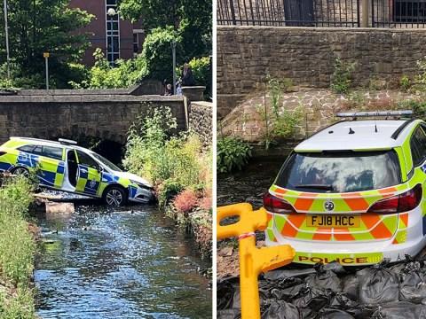 Police car smashes through wall and into river during crash