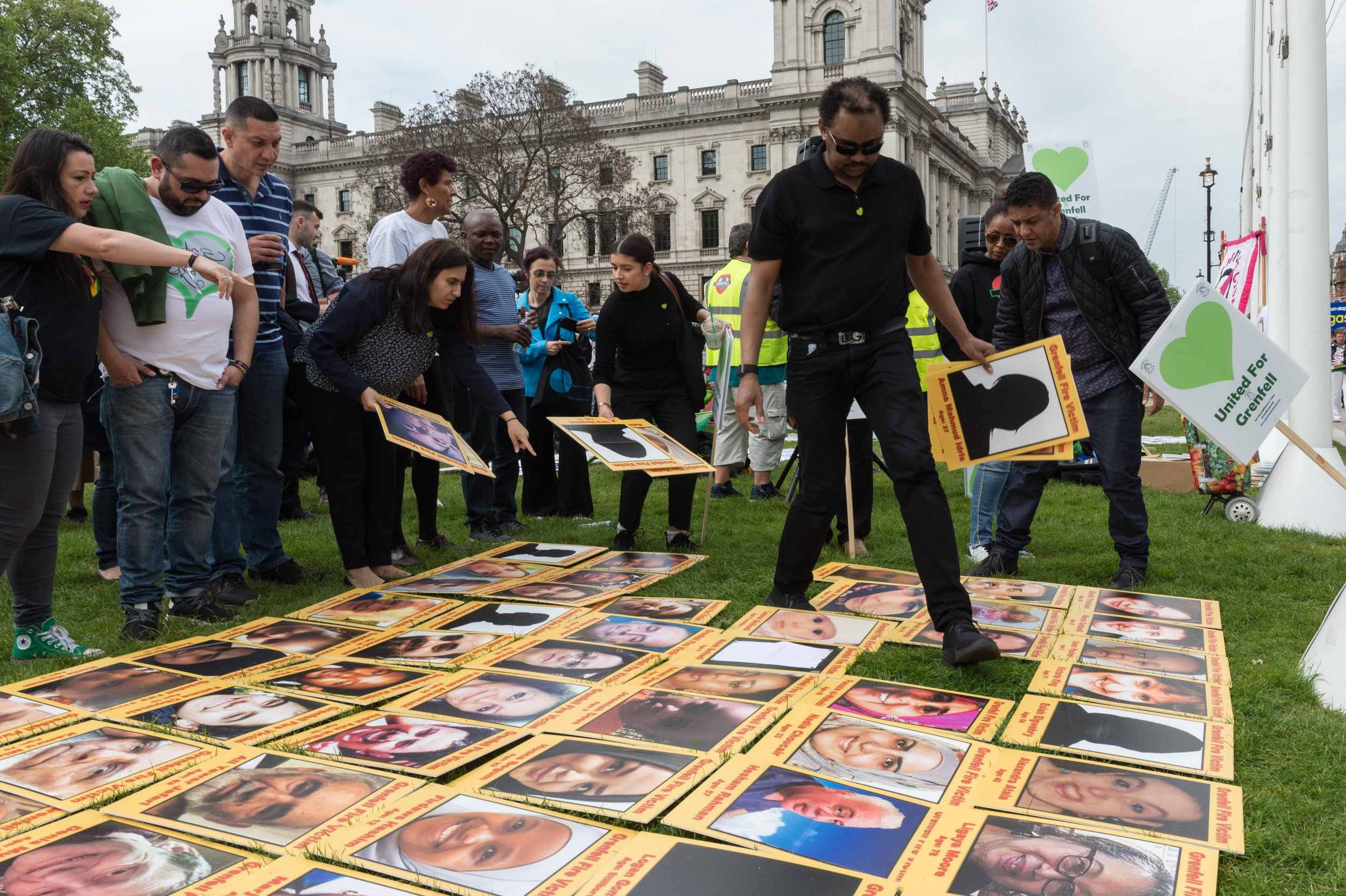 LONDON, UNITED KINGDOM - MAY 14: The Grenfell community of survivors, bereaved families and supporters gather in Parliament Square in central London in a peaceful protest as Members of Parliament debate a petition signed by over 150,000 people asking for appointment of a panel of decision making experts to sit alongside Sir Martin Moore-Bick in the Grenfell Tower Public Inquiry, which is due to commence on 21st May 2018. The protesters demand a panel of experts to be involved to avoid collapse of confidence in an inquiry set up to establish the cause and accountabilities involved in the Grenfell Tower fire on 14th June 2017 in which 71 people died. May 14, 2018 in London, England.PHOTOGRAPH BY Wiktor Szymanowicz / Barcroft Images