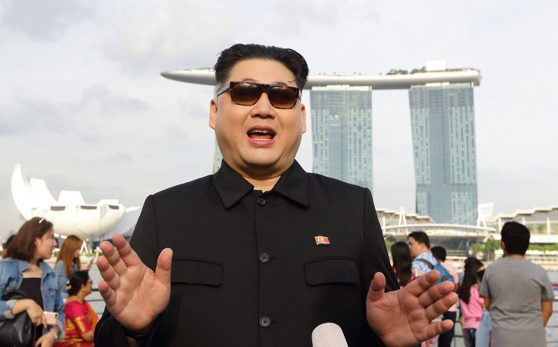 SINGAPORE - MAY 27: A Kim Jong Un impersonator, Howard X gives an interview at Merlion Park on May 27, 2018 in Singapore. The proposed North Korea-United States summit between U.S. President Donald Trump and North Korean leader Kim Jong Un was originally set for June 12, 2018 in Singapore, however, the U.S. has since officially backed out of the summit. (Photo by Suhaimi Abdullah/Getty Images)