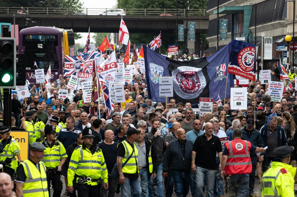 ? Licensed to London News Pictures . 02/06/2018. Manchester, UK . Approximately 1,000 DFLA supporters march along Oxford Road in Manchester City Centre . The Democratic Football Lads Alliance demonstrate in Manchester , eleven days after the first anniversary of the Manchester Arena terror attack . Photo credit : Joel Goodman/LNP