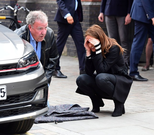 BGUK_1251079 - *EXCLUSIVE* LONDON, UNITED KINGDOM - *WEB MUST CALL FOR PRICING* *STRICT WEB EMBARGO UNTIL 5pm UK TIME ON 3rd JUNE 2018* The Grand Tour presenter Jeremy Clarkson gets his hands dirty as he helps and shows Alexandra Felstead Aka Binky from Made in Chelsea to change her car tyre. Pics taken: 31/05/2018 Pictured: Jeremy Clarkson - Alexandra Felstead BACKGRID UK 3 JUNE 2018 UK: +44 208 344 2007 / uksales@backgrid.com USA: +1 310 798 9111 / usasales@backgrid.com *UK Clients - Pictures Containing Children Please Pixelate Face Prior To Publication*
