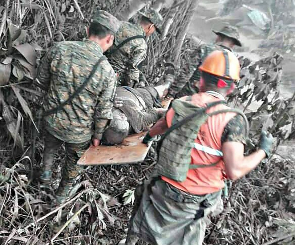 This handout picture released by the Guatemalan National Army shows army personnel as they evacuate a victim of Guatemala's Volcano Fuego eruption in El Rodeo, Guatemala on June 3, 2018. At least six people were killed when Guatemala's Fuego volcano erupted, belching ash and rock and forcing the airport to close. The strong eruption was the second major one this year. The dead were from farming communities just south of the volcano who were trapped by hot lava flow, National Disaster Relief Agency spokesman David de Leon told reporters / AFP PHOTO / AFP PHOTO AND Guatemala National Army / HO / RESTRICTED TO EDITORIAL USE - NO MARKETING NO ADVERTISING CAMPAIGNS - DISTRIBUTED AS A SERVICE TO CLIENTS HO/AFP/Getty Images